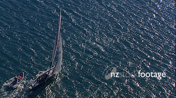 NZL57 Americas Cup Yacht Sailing into the Sun, Aerial 2705