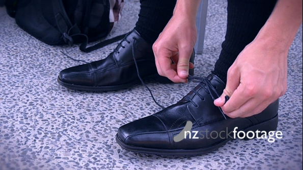 Student Tying Shoe Laces 3876