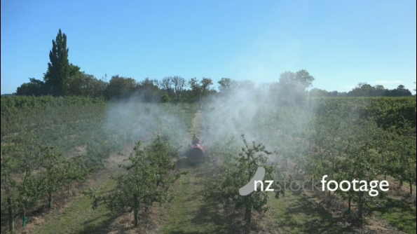 Spraying in Orchard Wide Shot HD 24778