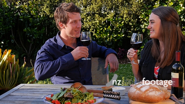 Couple Drinking Red Wine with Meal and Kiss 1 4441