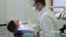 Portrait Of Dentist Smiling At Camera With Customer In Hospital 11854