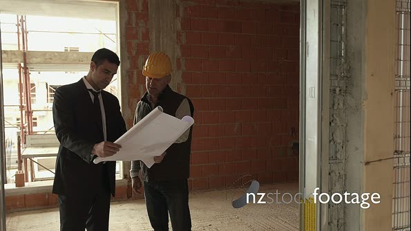 Plumber And Architect Talking In Construction Site With Building 11988