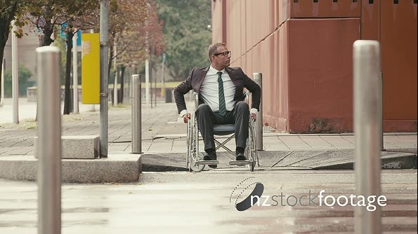 Business People On Wheelchair Crossing Street 12142
