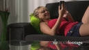 Blond Woman Relaxing On Sofa Surfing Internet With Phone 13289