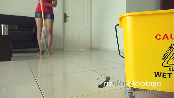 Woman Chores Cleaning Floor At Home With Yellow Bin 13294
