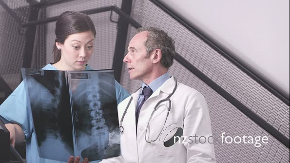 Doctor holding x-ray with nurse 13642