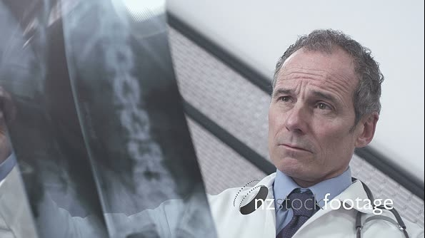 Male doctor watching over x-ray 13646