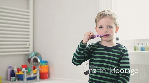 Boy brushing teeth 13666