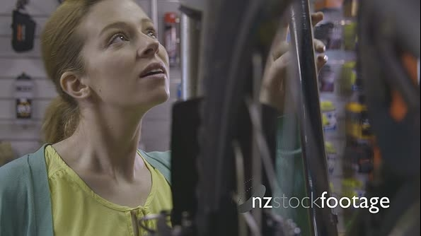 Woman standing in bicycle shop 13697