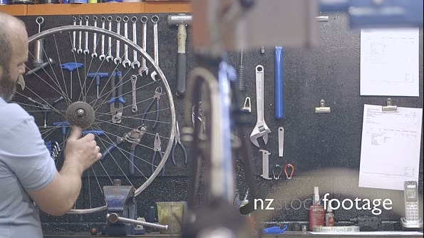 Man repairing bicycle 13720