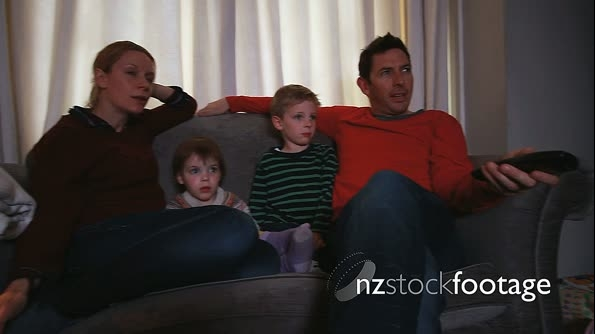 Family relaxing on sofa together 13826