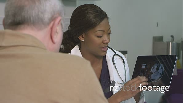 Female doctor using tablet 14369