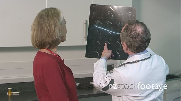 Male doctor using x-ray and discussing with patient 14413