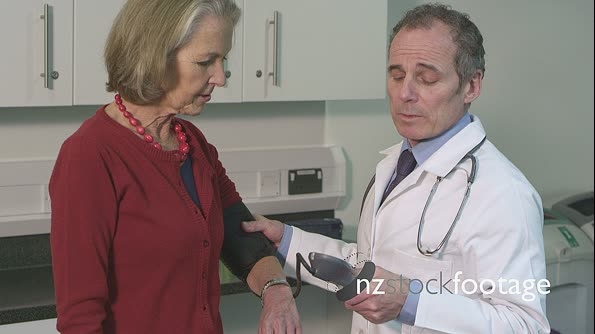 Doctor checking pulse trace of patient 14415