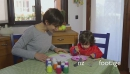 Mother And Daughter Having Fun With Paint At Home 14739