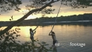 Couple enjoying rope swing 15983