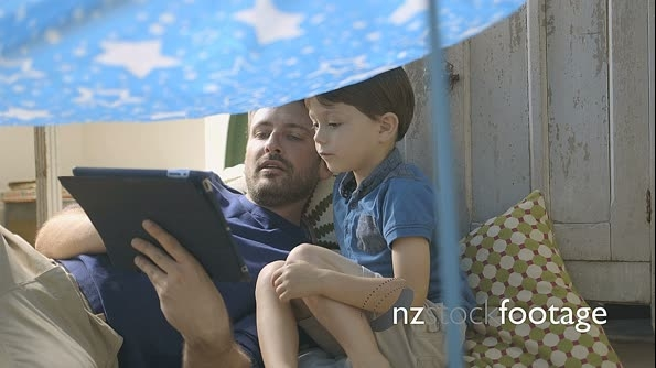 Father using tablet with his son 16064