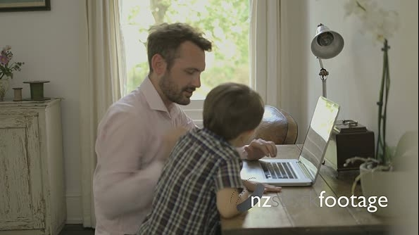 Father and son with laptop 16132