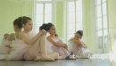 MLS Three Young Ballerinas crouch on the floor resting 16350