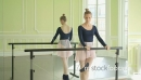 MLS Female Ballet Dancer stretches using the Studio Ballet barre 16351