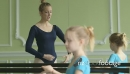 MS Female Ballet Dancer supervises a younger Ballerina and teach 16394