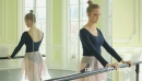 MLS Female Ballet Dancer stretches using the Studio Ballet barre 16402