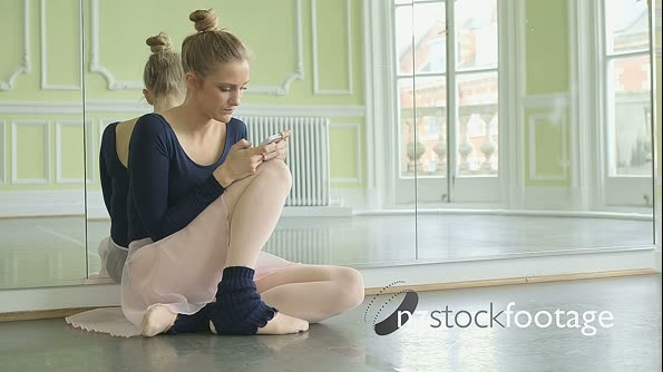 MLS Female Ballet Dancer crouches in front of the mirror using s 16425