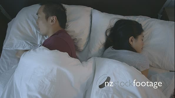 Couple sleeping on bed 16944