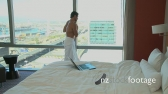 LS PAN OF A BUSINESSMAN IN A TOWEL IN HIS HOTEL ROOM 17408