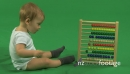 LS OF A BABY PLAYING WITH AN ABACUS 18011