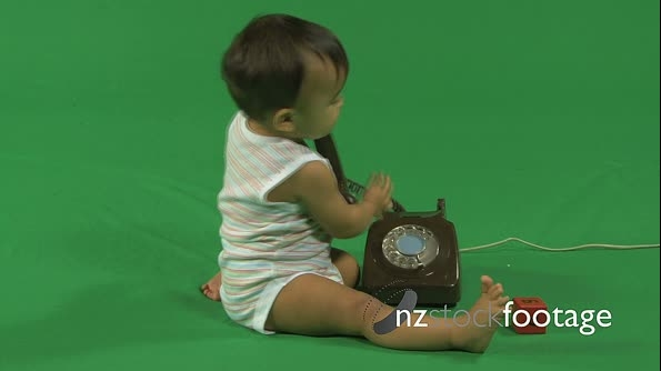 LS OF A BABY PLAYING WITH A TELEPHONE 18027