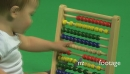 ZO LS OF A BABY PLAYING WITH AN ABACUS 18030