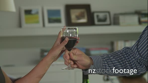 Close up  off couple toasting with wine glasses 19334
