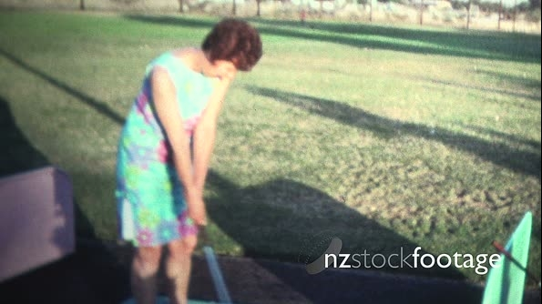 (8mm Vintage) 1971 Women in Dress At Driving Range 19518