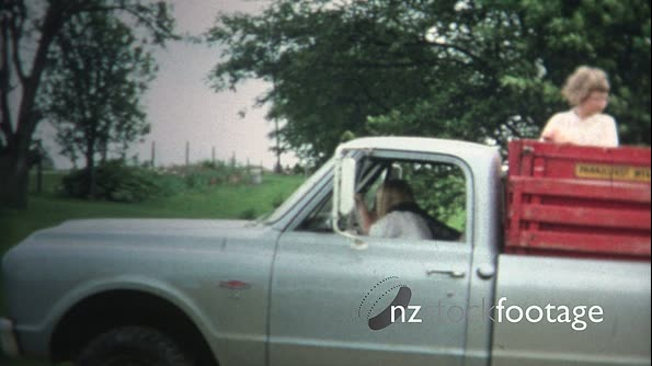 (8mm Vintage) 1966 Girls Riding Back Of Farm Truck in Iowa, USA. 19643