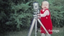 1971: Baby hilariously working the camera on a tripod. 19992