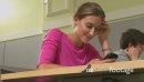 Female student on mobile phone texting at her desk 20143