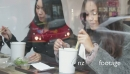 MS Two females eating in sushi restaurant 20347