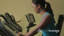 Female work out on bicycle in a gym 20472