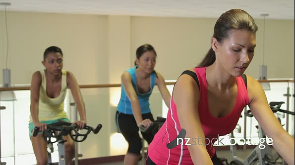 Group working out on bicycles in a gym 20475
