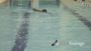 Male swimming in swimming pool in gym 20476