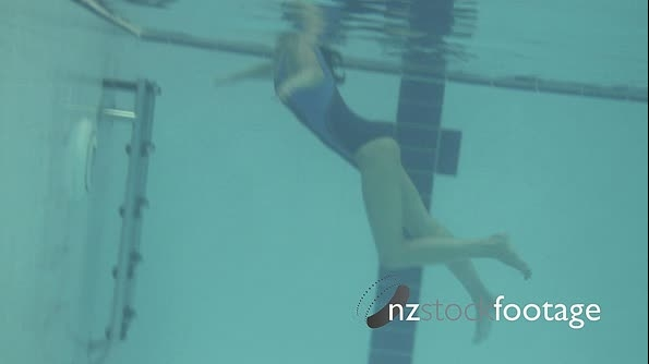 Female swimming in swimming pool in gym 20479