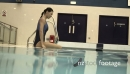 Female going into swimming pool in gym 20504
