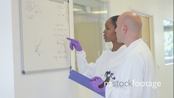 Scientist analyze and discuss research data on white board in science laboratory 20576