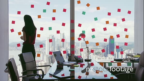 2 Business Person Attaching Sticky Notes On Large Window 20897