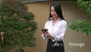 Beautiful Asian Woman Talking On Mobile Phone Near Office Building 20943