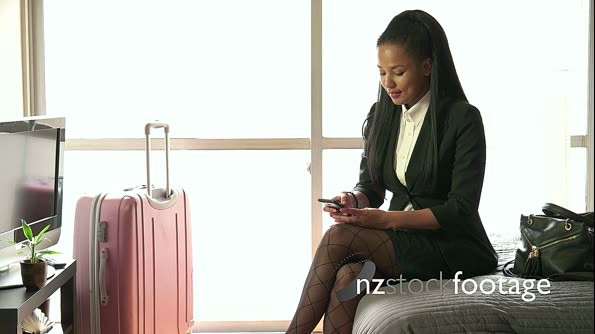 Black Businesswoman Talking On Phone In Hotel Room Business Travel 20951