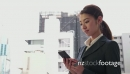 Happy Japanese Asian Businesswoman Talking On Phone Near Office Buildings 20958