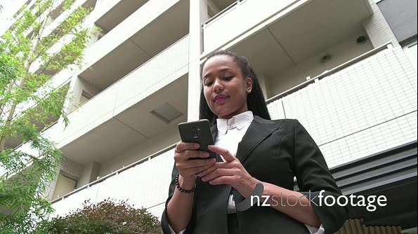 Multiethnic Young Woman Talking On Telephone Smartphone Near Office Skyscrapers 20965