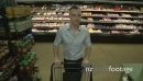 Pushing a shopping cart in a grocery store (1 of 4) 21263